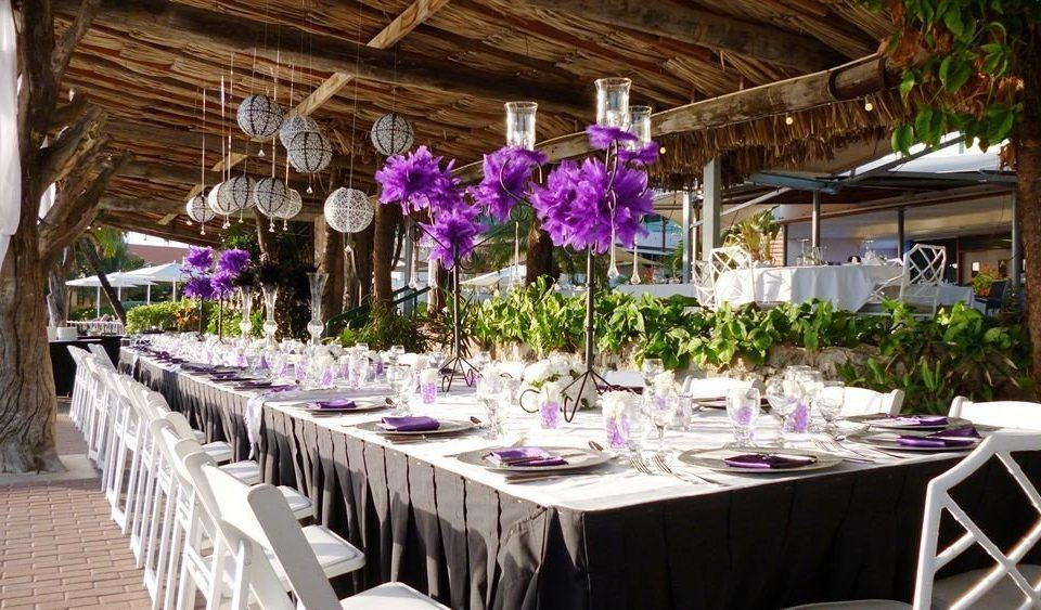 Bar Beachfront Dining Drink Eat Romantic flower flower arranging centrepiece floristry function hall wedding reception wedding ceremony banquet Party aisle quinceañera floral design event rehearsal dinner restaurant dining table