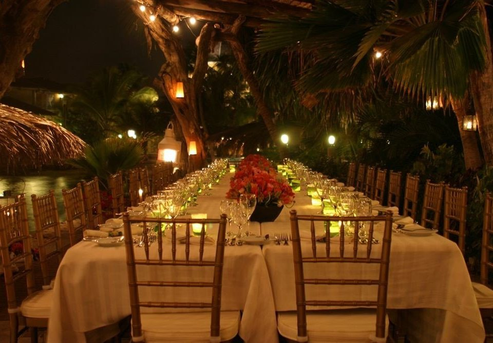 Bar Beachfront Dining Drink Eat Romantic function hall restaurant wedding reception Resort banquet ballroom night dining table