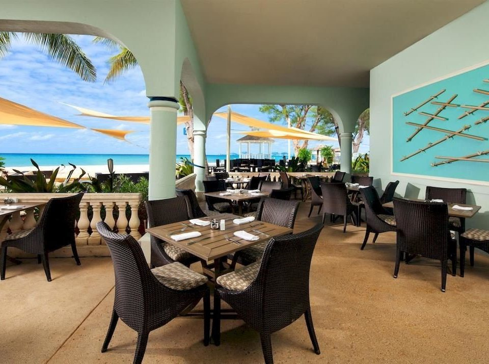 Bar Beachfront Dining Drink Eat Scenic views chair property restaurant home Resort dining table