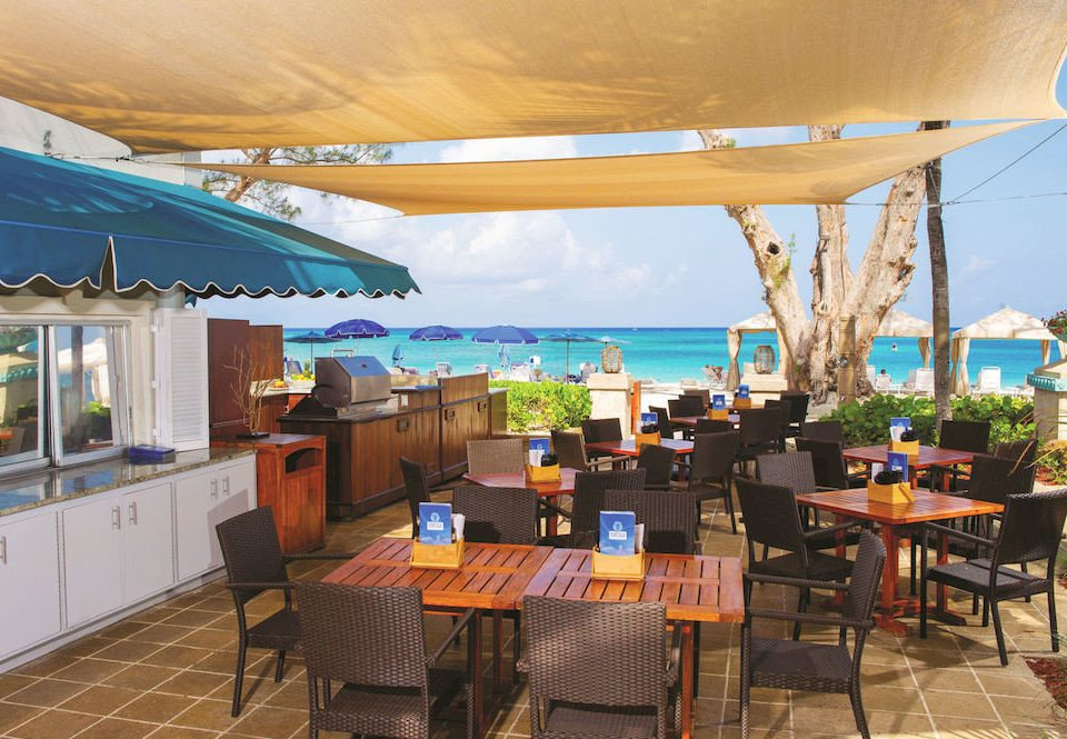 Bar Beachfront Dining Drink Eat Scenic views chair property restaurant Resort Villa