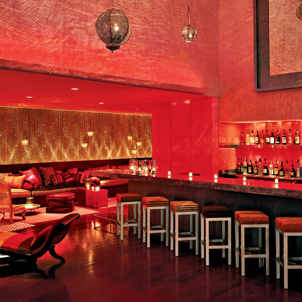 Beachfront Dining Drink Eat Honeymoon Lobby Lounge Luxury Nightlife Play Pool Resort Romance Waterfront red restaurant Bar function hall nightclub