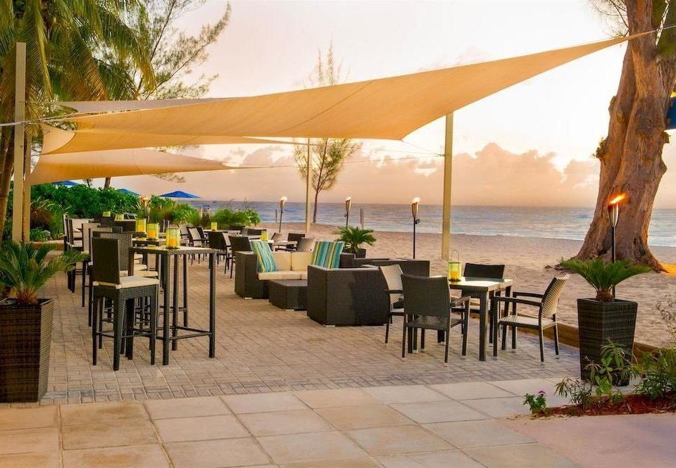 Bar Beachfront Dining Drink Eat Scenic views tree umbrella chair ground leisure property Resort restaurant Villa hacienda shore day