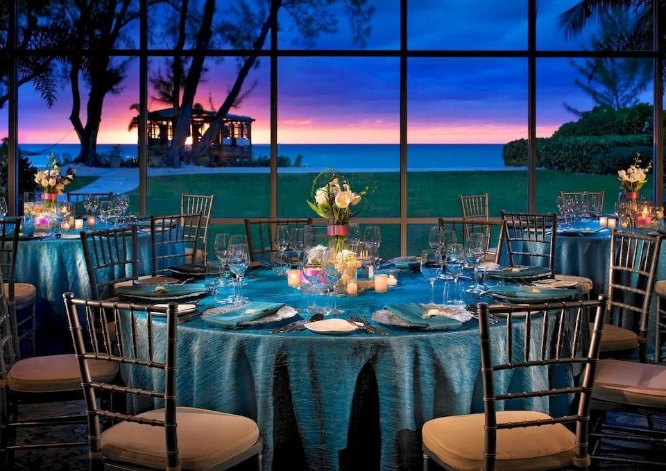 Bar Beachfront Dining Drink Eat Scenic views chair Resort restaurant function hall set dining table