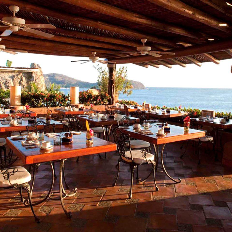 Bar Beachfront Dining Drink Eat Romantic Scenic views chair restaurant Resort wooden hacienda Villa