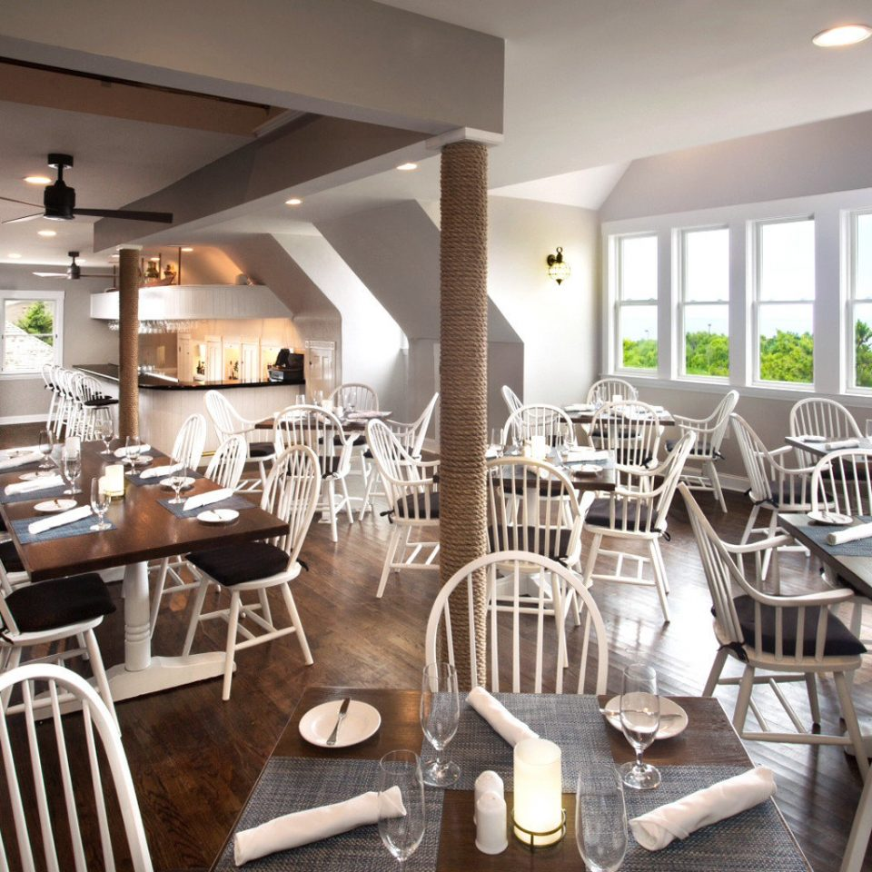 Beachfront Dining Drink Eat Resort Scenic views Waterfront chair property Kitchen wooden restaurant home condominium dining table Bar