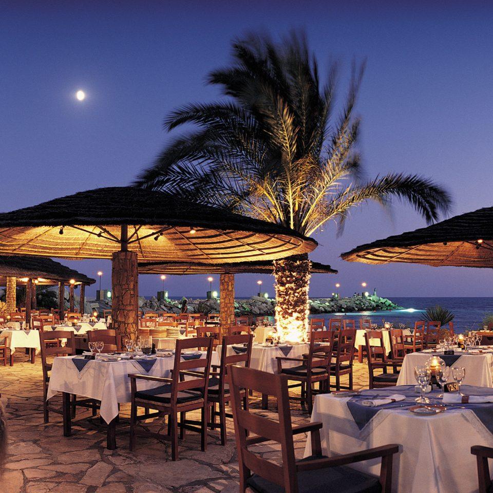 Bar Beachfront Dining Drink Eat Elegant Luxury Modern Scenic views chair umbrella Resort evening set restaurant day