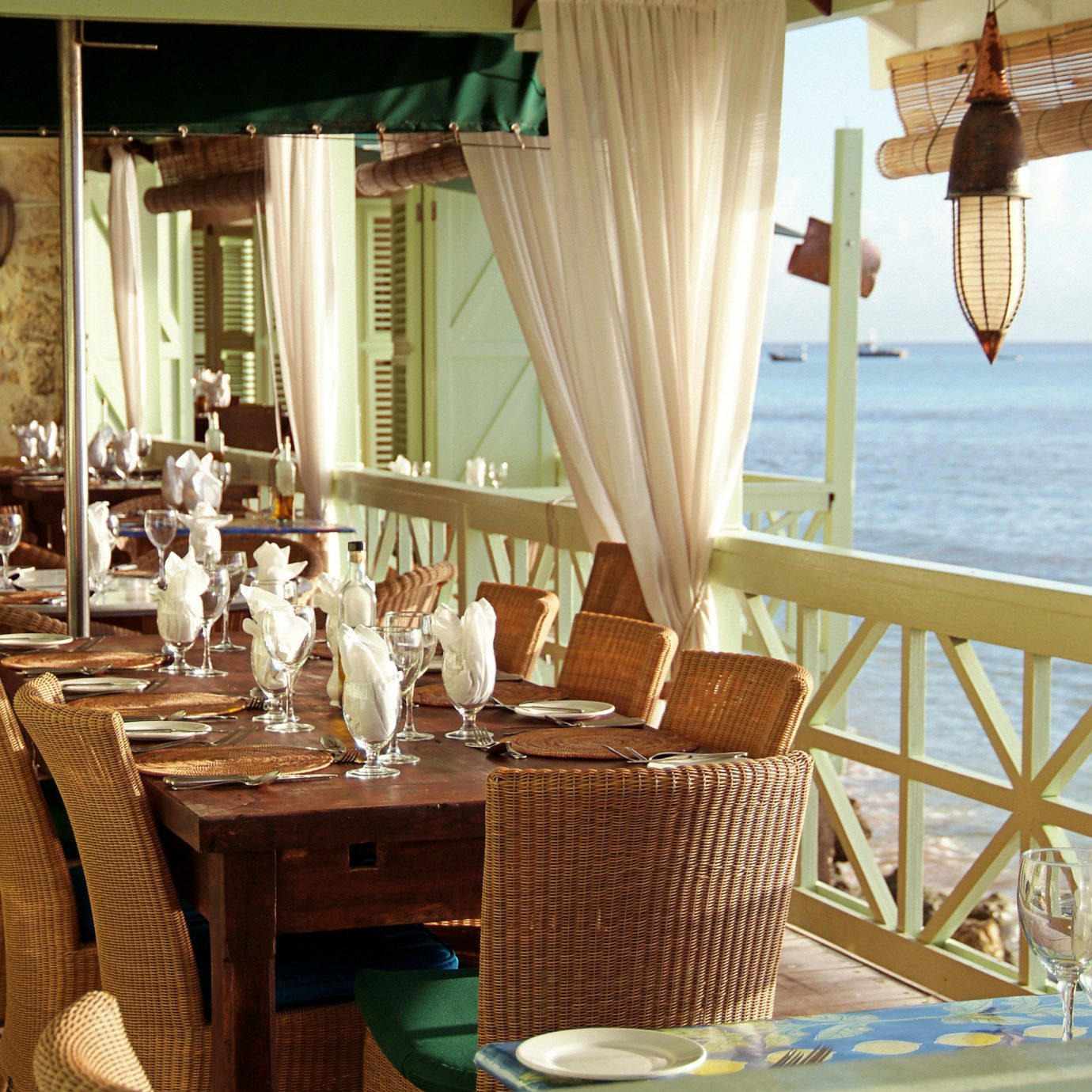 Bar Beachfront Dining Drink Eat Scenic views chair property restaurant Resort home Villa cottage set dining table
