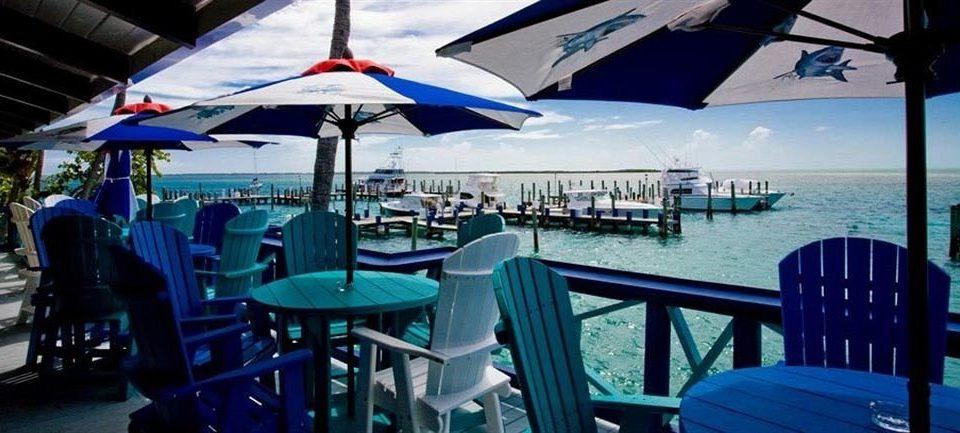 Bar Beachfront Dining Drink Eat Luxury Ocean chair leisure Resort restaurant caribbean vehicle