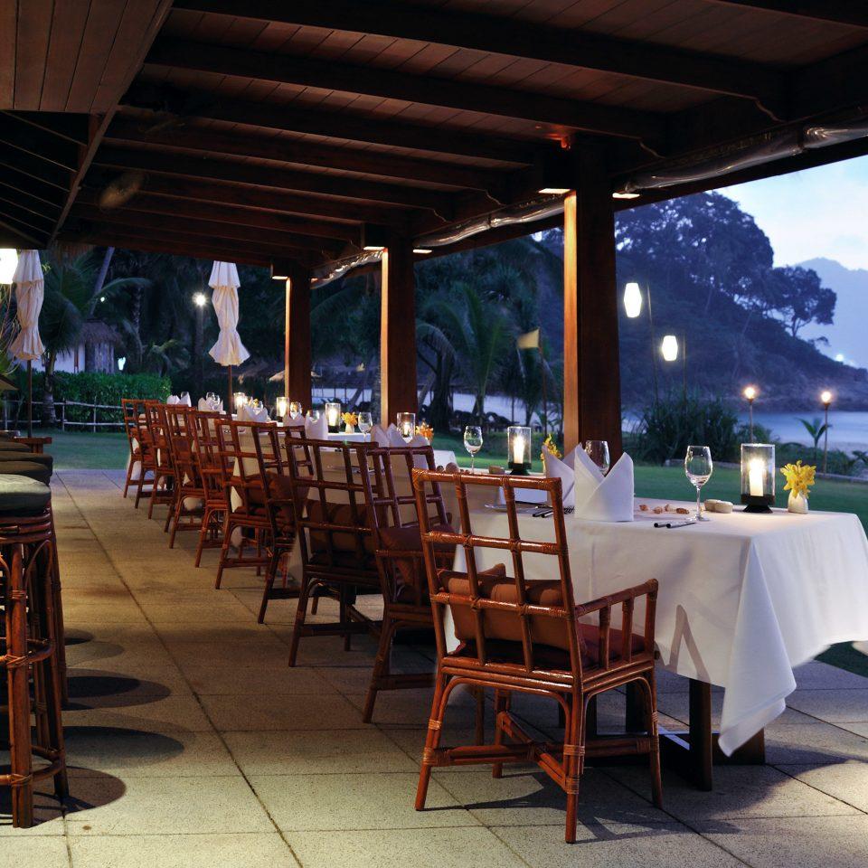 Beachfront Dining Drink Eat Resort Scenic views chair restaurant Bar