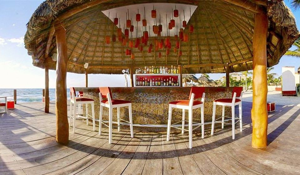 Bar Beachfront Dining Drink Eat Hip Luxury Modern Romantic leisure Resort amusement park walkway pavilion outdoor structure park gazebo amusement ride
