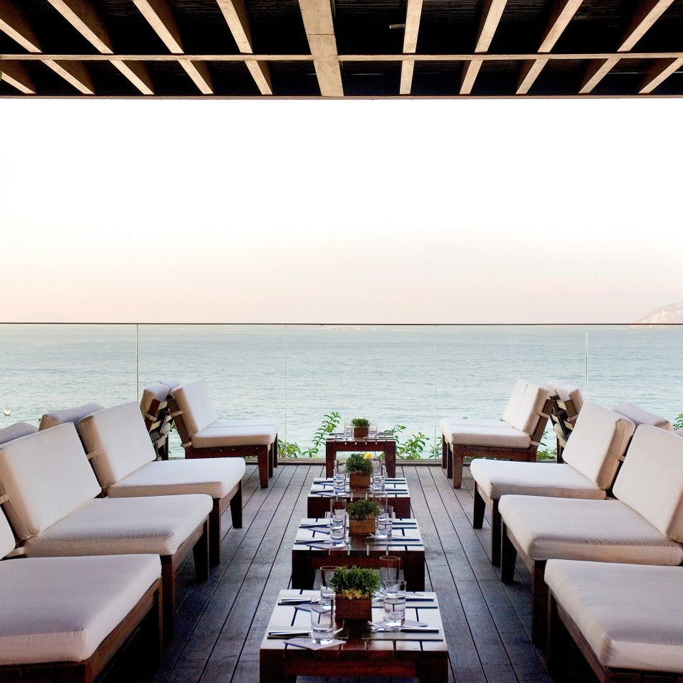 Bar Beachfront Dining Drink Eat Hip Hotels Modern Romance Scenic views tree property Resort Villa restaurant overlooking