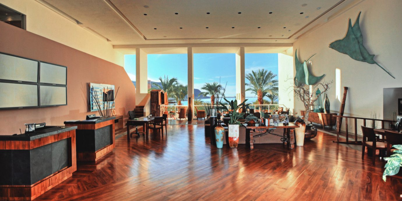 Bar Beachfront Dining Drink Eat property Lobby flooring home wood flooring Resort mansion ballroom hard