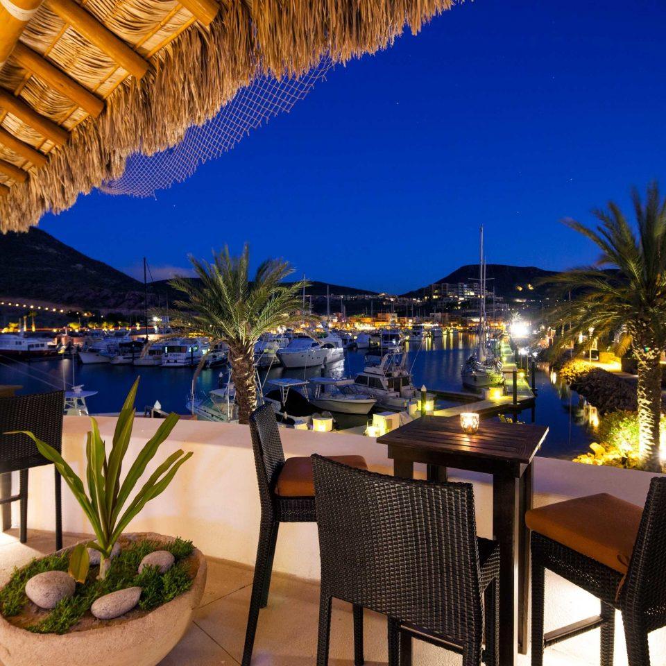 Bar Beachfront Dining Drink Eat Nightlife Patio Romantic chair Resort property restaurant Villa condominium set