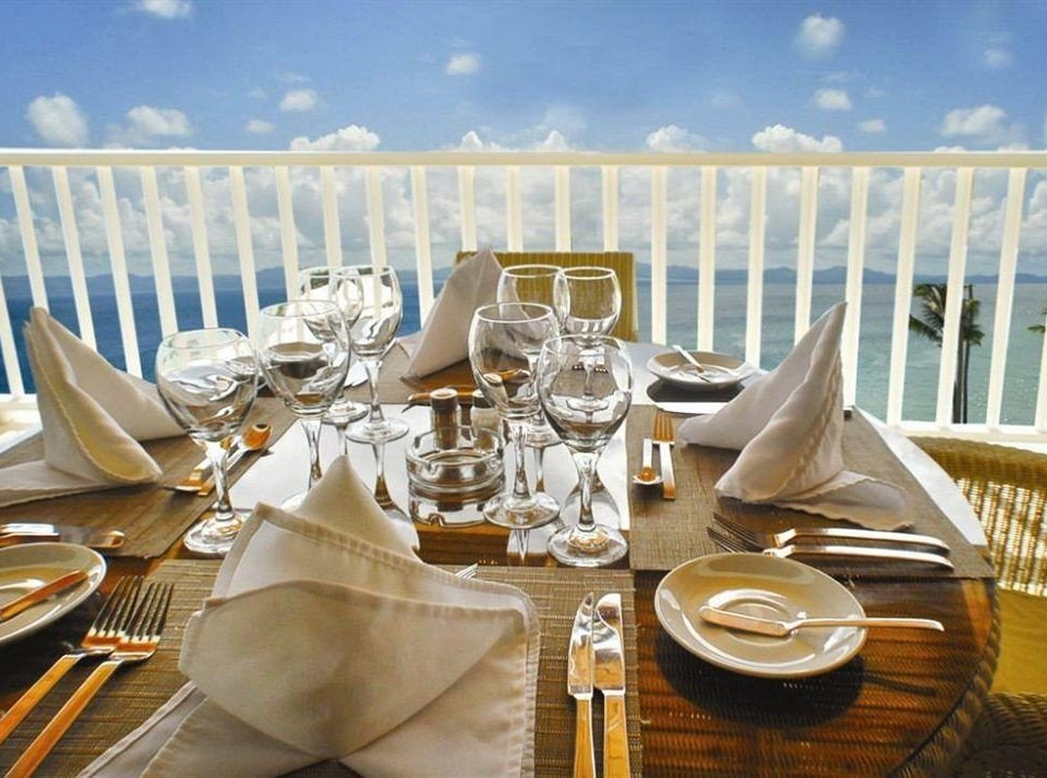 Bar Beachfront Dining Eat Kitchen Luxury Romantic Scenic views Tropical restaurant wedding yacht banquet ceremony vehicle rehearsal dinner dinner Drink dining table
