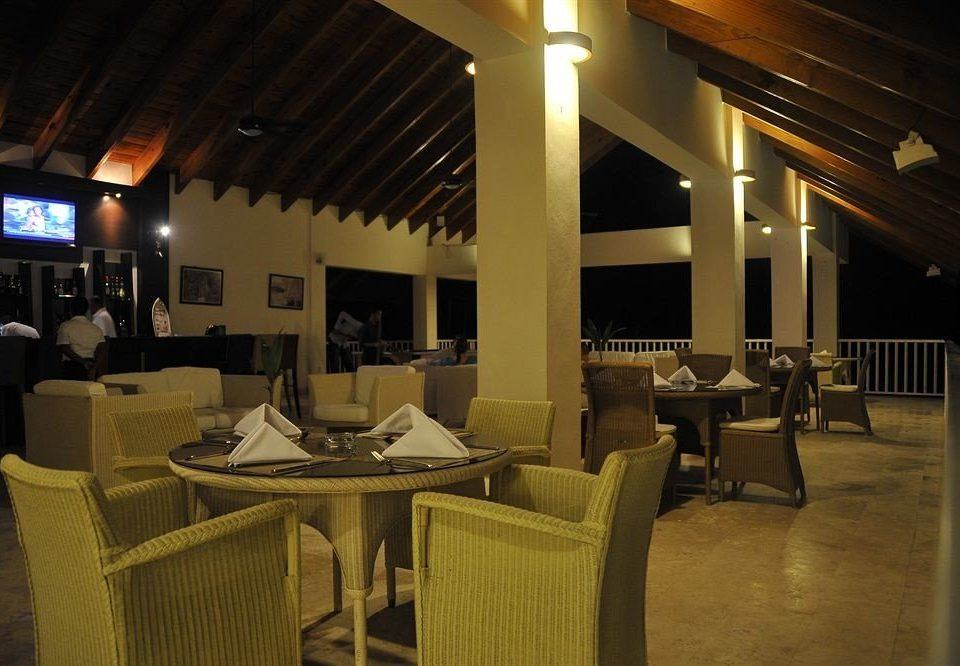 Bar Beachfront Dining Drink Eat Kitchen Luxury Romantic Scenic views Tropical chair restaurant lighting function hall