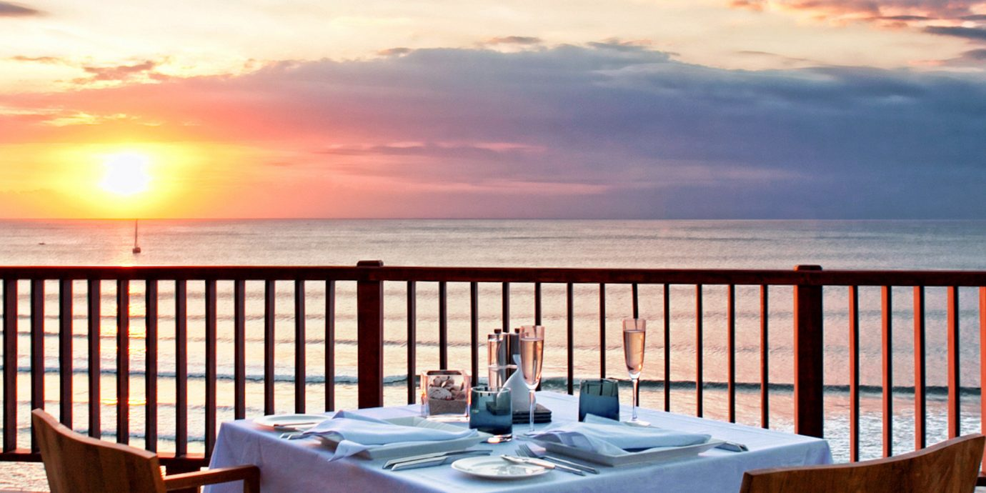 Bar Beachfront Dining Drink Eat Nightlife Scenic views sky chair water property Ocean overlooking Resort set dining table