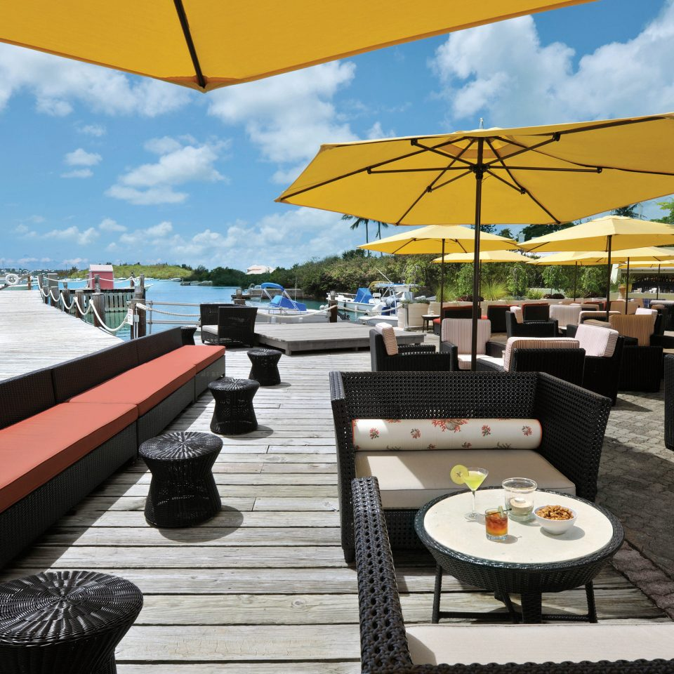 Bar Beachfront Dining Drink Eat Hotels Scenic views sky leisure umbrella accessory restaurant Resort vehicle yacht