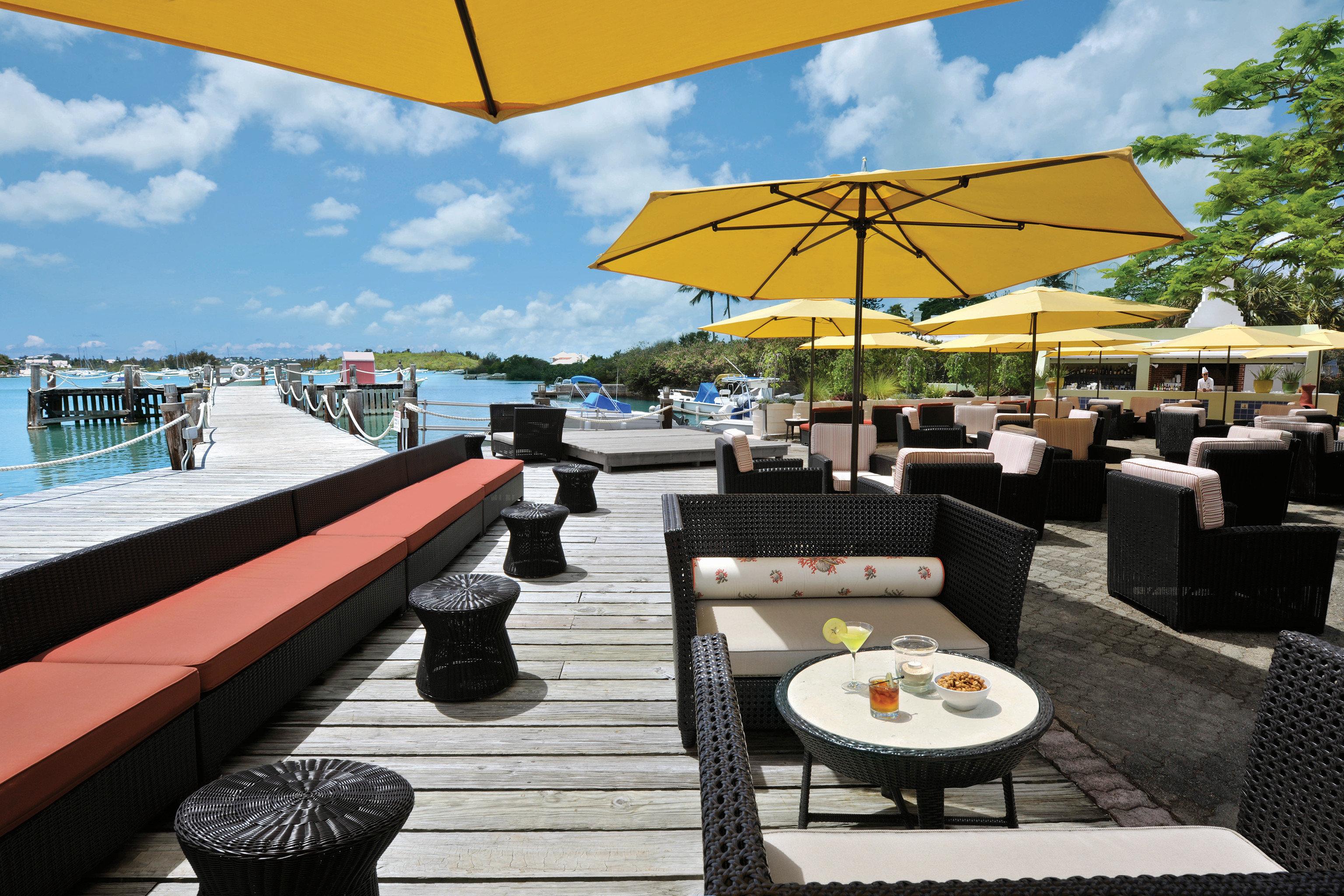 Bar Beachfront Dining Drink Eat Hotels Scenic views sky leisure umbrella accessory restaurant Resort vehicle yacht