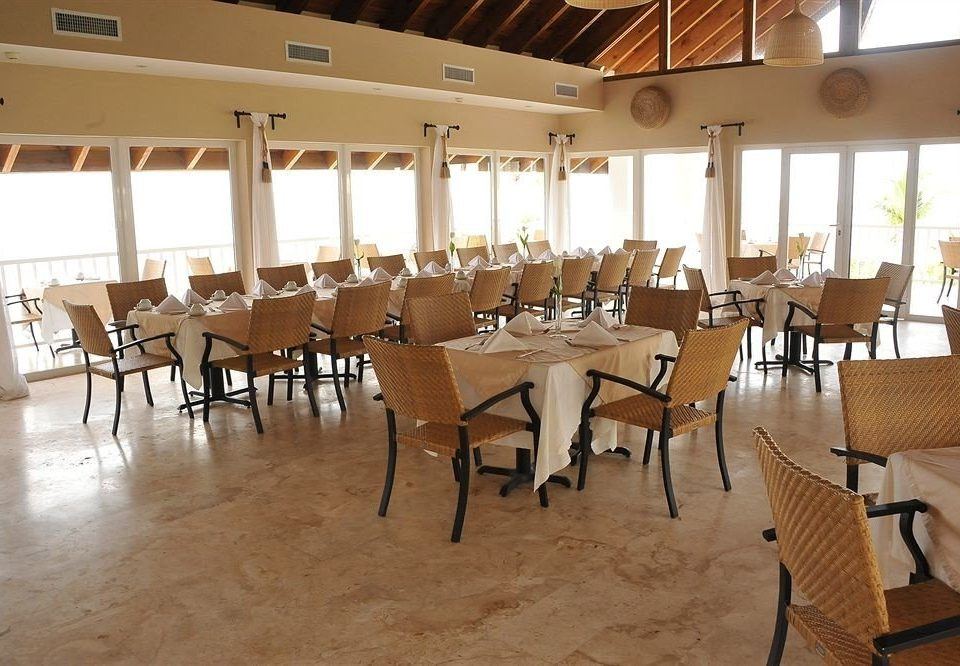 Bar Beachfront Dining Eat Kitchen Luxury Romantic Scenic views Tropical chair property restaurant function hall Resort banquet cafeteria dining table