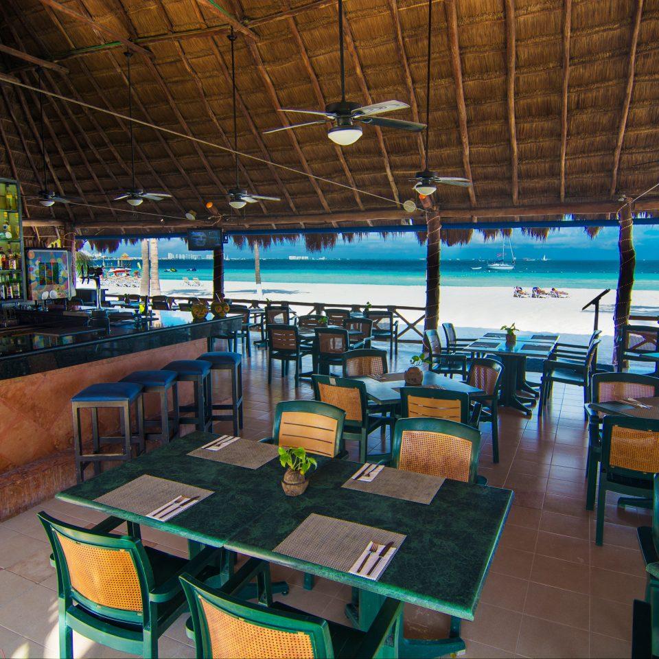 Beachfront Dining Island chair restaurant Bar Resort