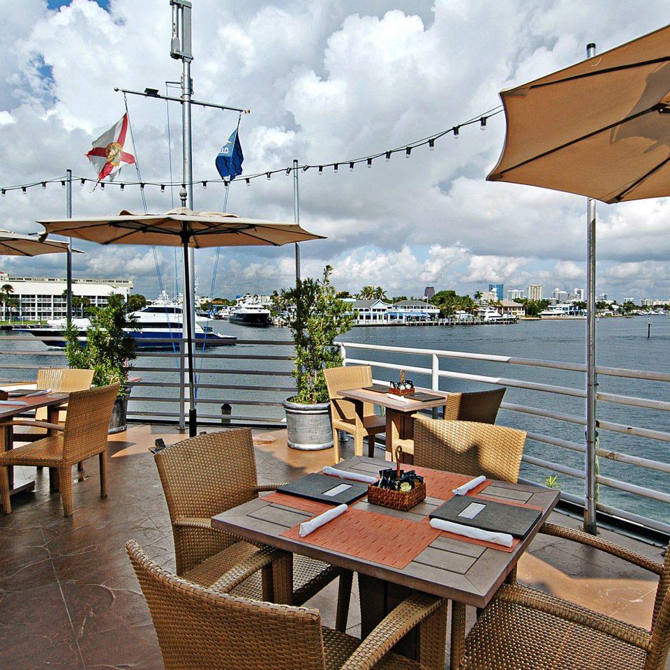 Bar Dining Drink Eat Scenic views Waterfront sky chair vehicle dock marina passenger ship ship yacht Sea Resort Boat restaurant watercraft day