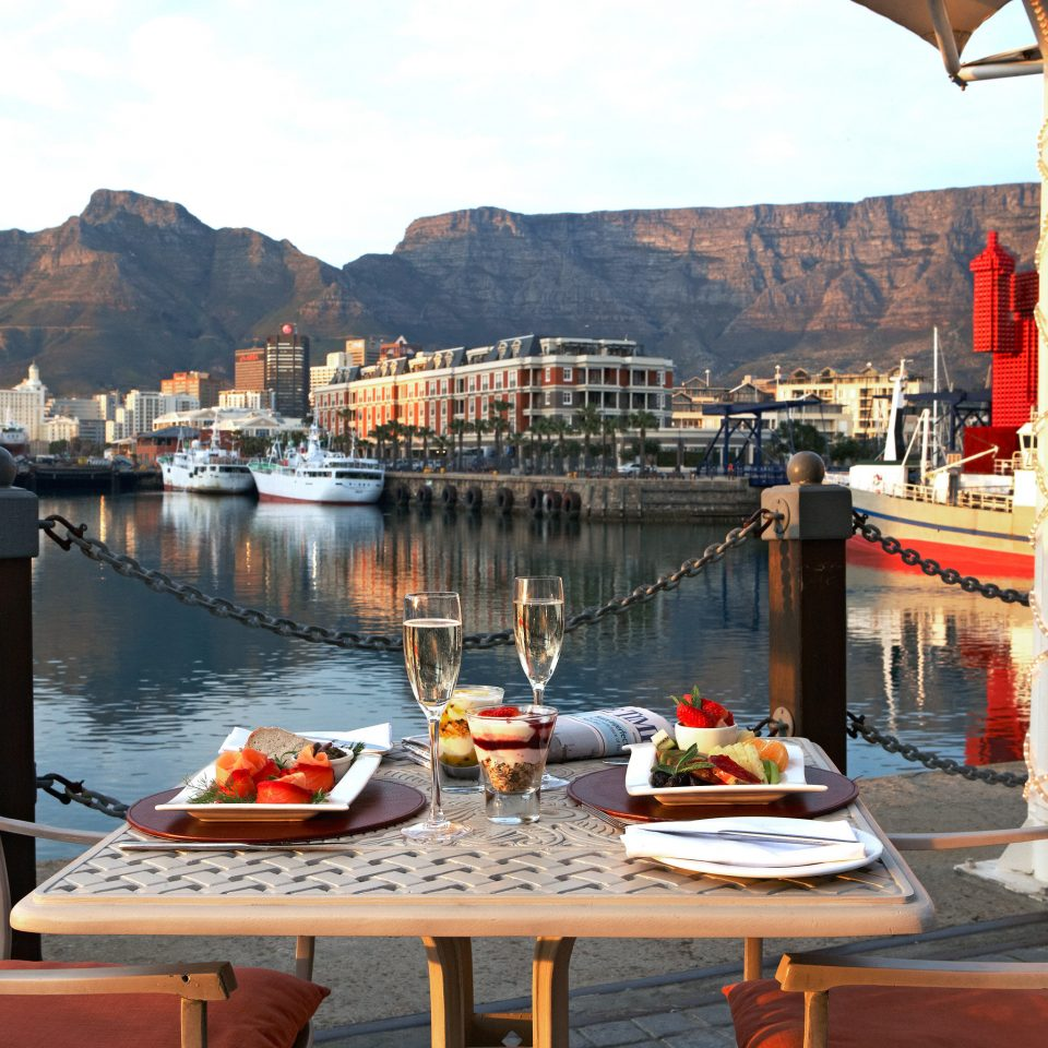 Bar Dining Drink Eat Romantic Scenic views Waterfront Town mountain vehicle Sea restaurant travel Boat waterway