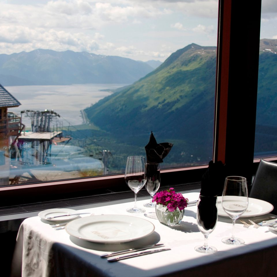 Bar Dining Drink Eat Hotels Lakes + Rivers Mountains Scenic views Trip Ideas Waterfront mountain sky house passenger ship yacht Boat swimming pool home restaurant vehicle luxury yacht overlooking