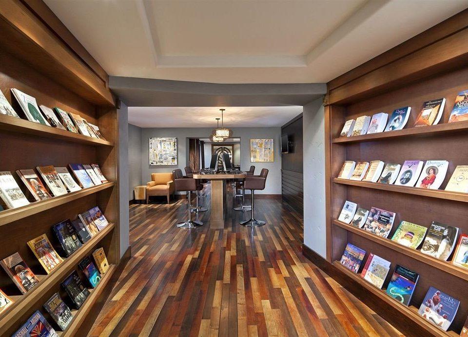 shelf book library building recreation room liquor store Bar retail
