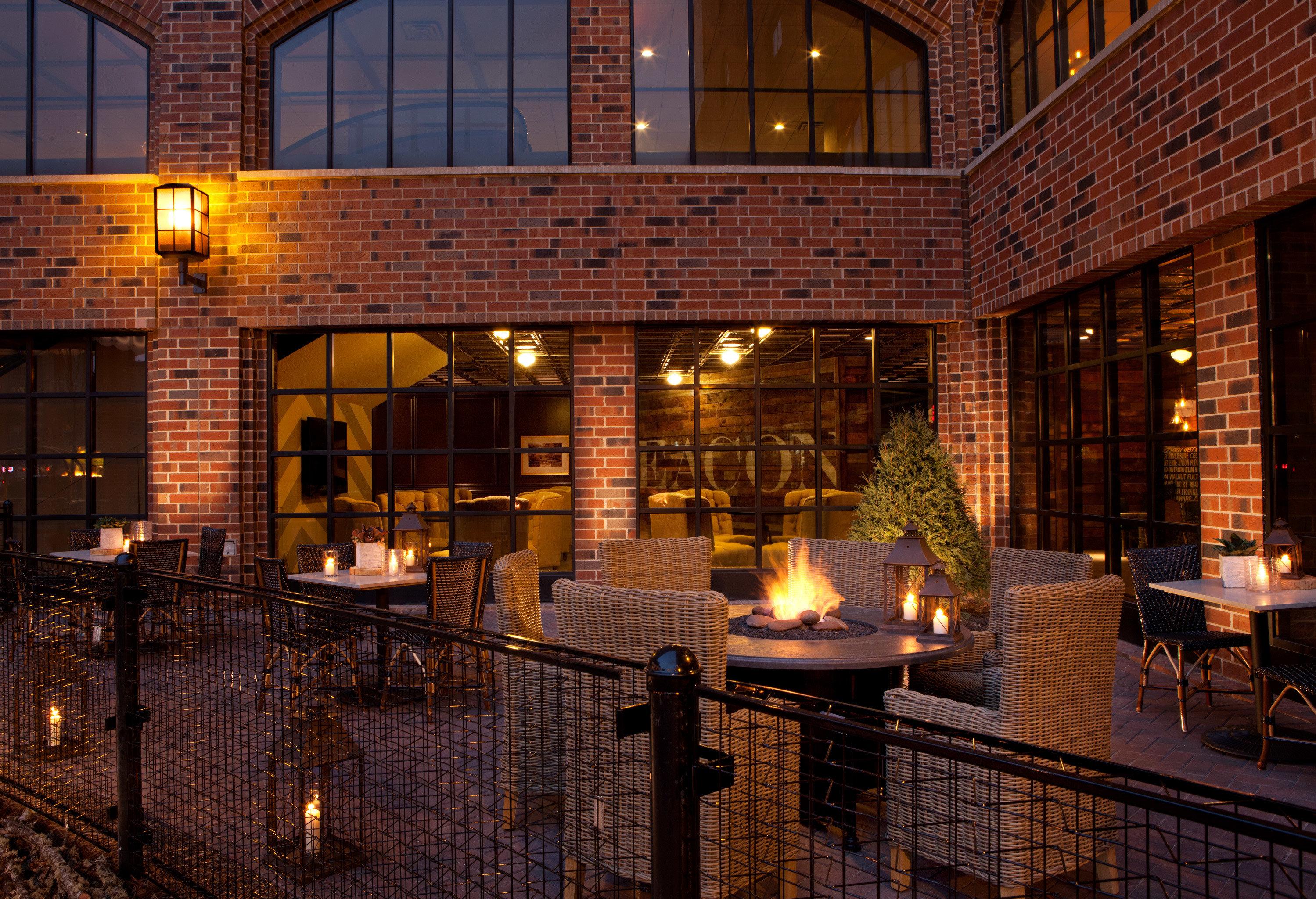 Boutique Deck Drink Eat Firepit Modern Patio building night lighting home brick evening landscape lighting Bar restaurant tiled tile