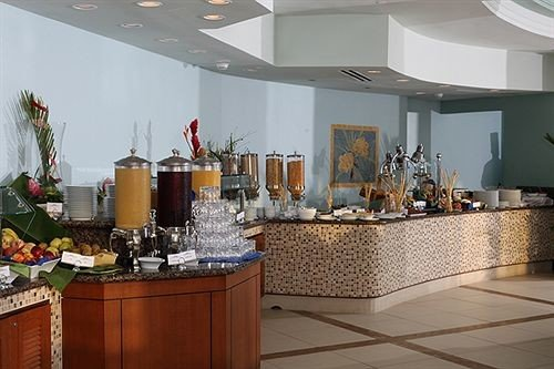 Bar Dining Drink Eat Kitchen property Lobby floristry home restaurant Boutique counter cluttered appliance Island