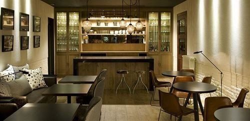 chair property Dining restaurant lighting condominium Bar nice Lobby Boutique leather dining table
