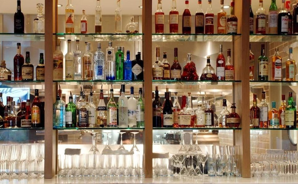 bottle shelf filled lots retail Boutique many Drink Bar liquor store full Shop