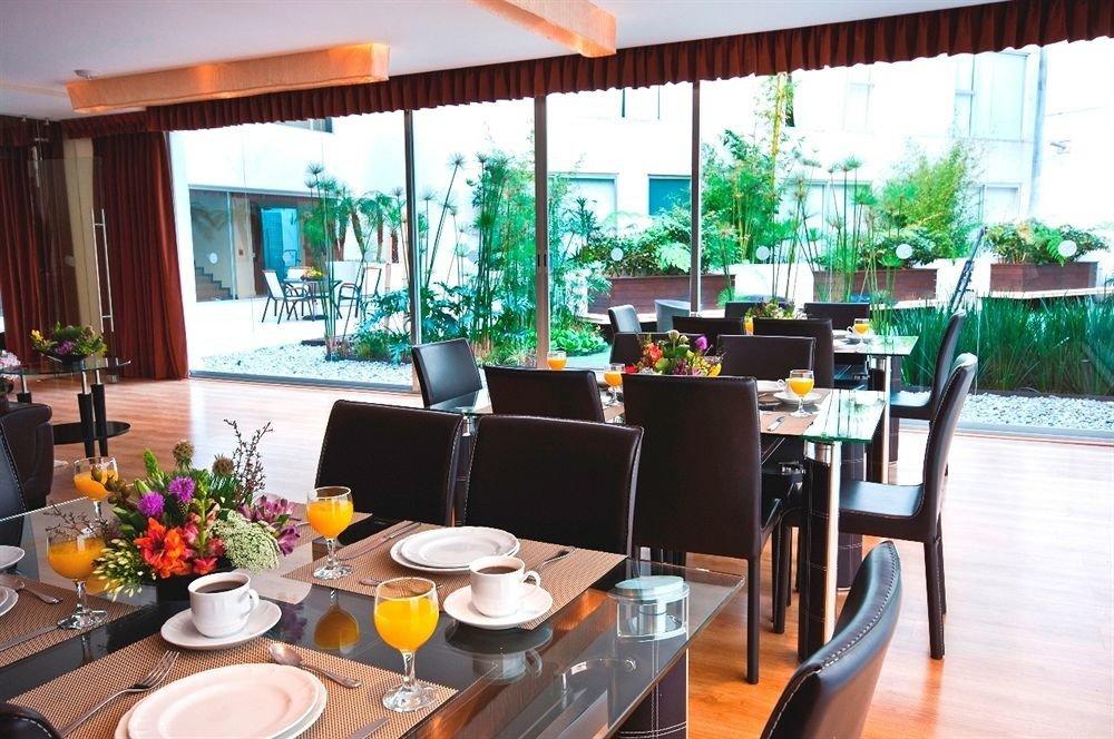 Budget Dining Drink Eat Modern chair property restaurant Resort condominium Bar dining table