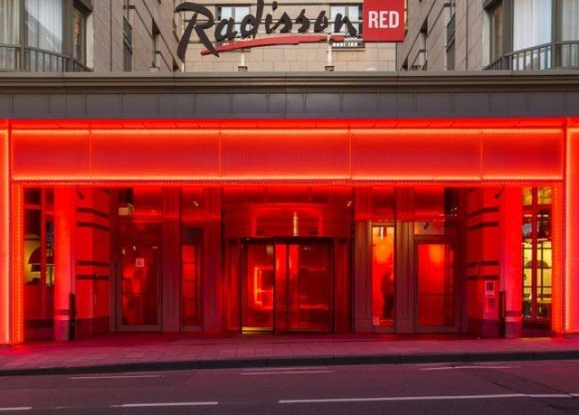 building road red street movie theater restaurant theatre retail signage Bar decker telephone booth