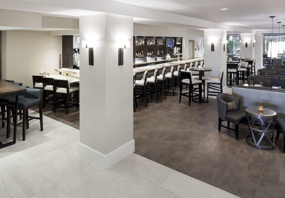 Bar Business Family property chair Dining flooring restaurant Lobby condominium