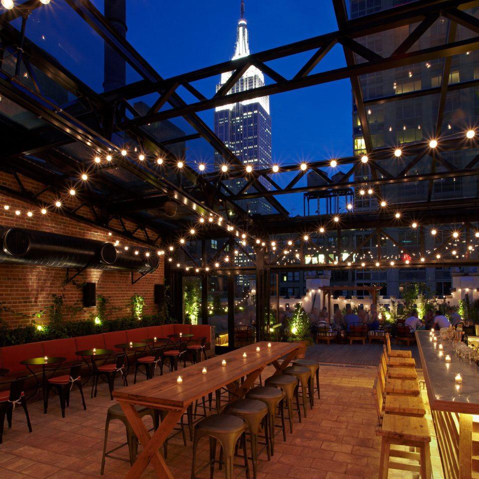 Bar City Drink Eat Modern Nightlife Patio Rooftop night evening lighting Resort convention center plaza restaurant line crowd