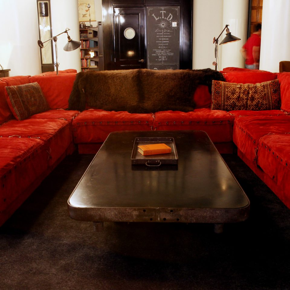 Bar City Drink Hip Lobby Lounge Modern sofa red living room seat couch flooring orange vehicle leather