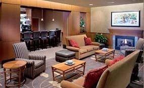 Bar Classic Lounge chair property living room Suite condominium Resort Lobby set