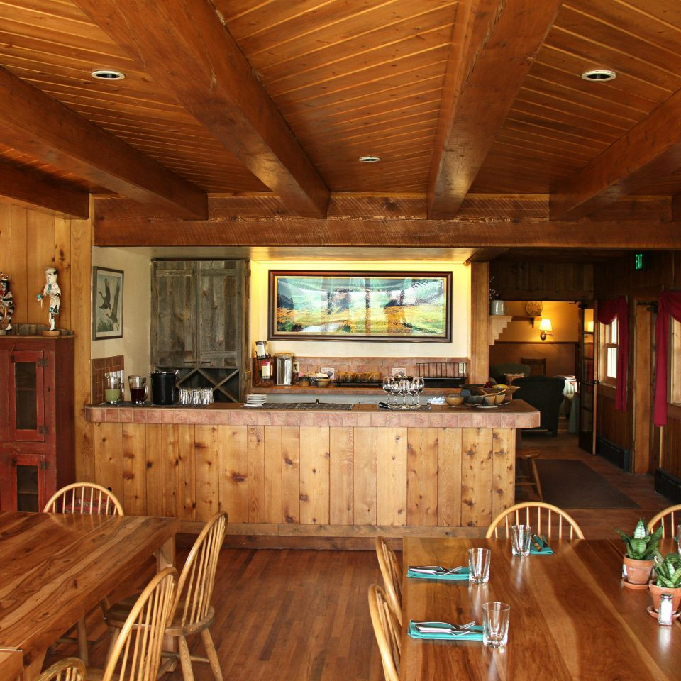 Country Dining Mountains Ranch Rustic log cabin property recreation room home hardwood wooden cottage living room farmhouse wood flooring mansion Kitchen Bar appliance Island