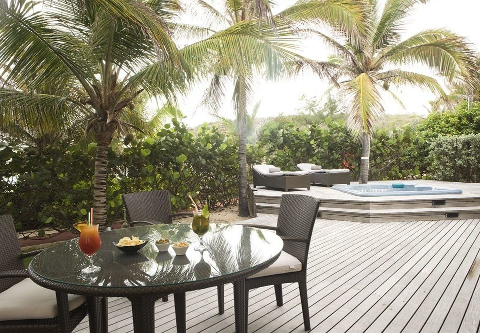Bar Dining Drink Luxury Modern property palm Resort Villa swimming pool condominium home backyard outdoor structure tree Courtyard cottage plant