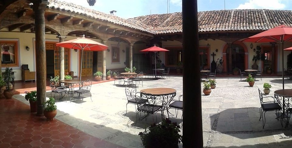 Bar Dining Drink Eat Rustic building property hacienda Resort restaurant Courtyard Villa mansion palace plaza porch