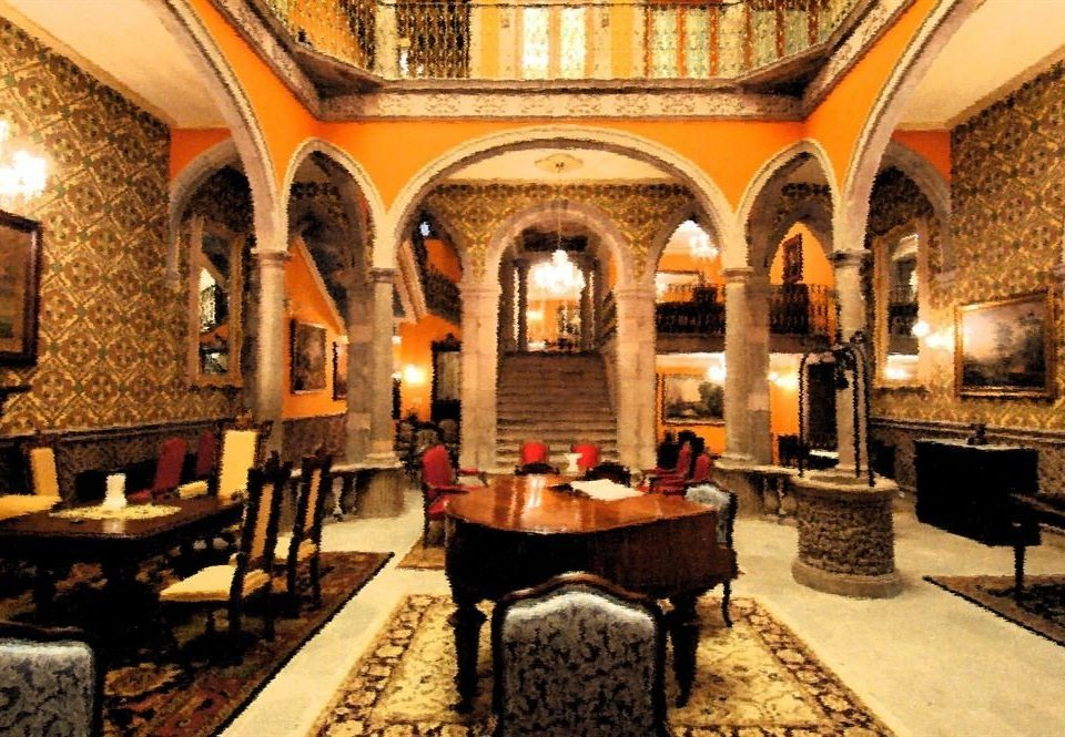 Bar Dining Drink Eat Historic Romantic property building Lobby palace hacienda mansion Villa stone Courtyard restaurant Resort