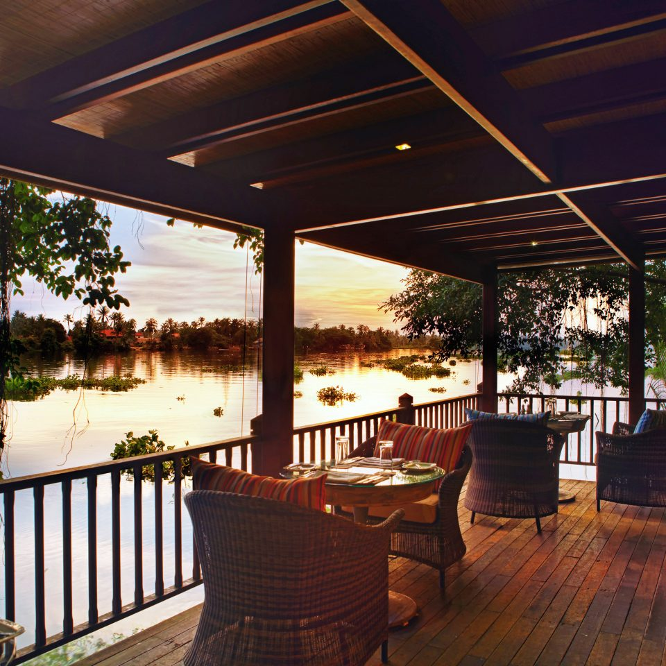 Bar Cultural Deck Dining Drink Eat Eco Jungle Nature River Scenic views Waterfront building Resort restaurant home outdoor structure porch