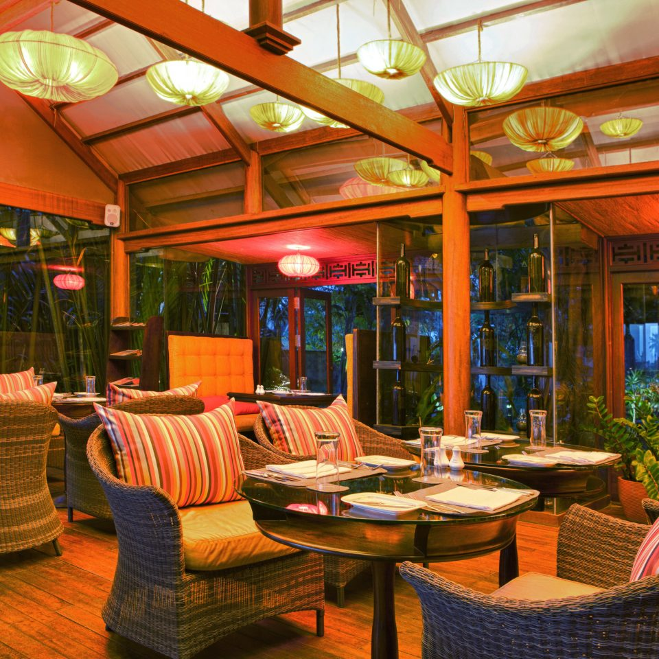 Bar Cultural Dining Drink Eat Jungle Lounge Nature River Waterfront chair Resort restaurant lighting home Lobby