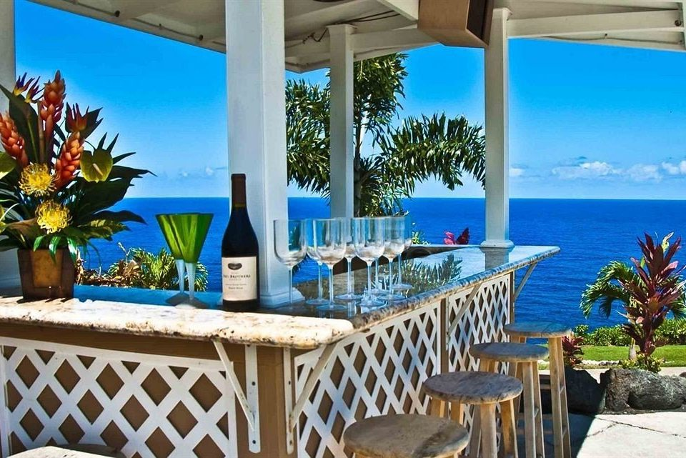 Bar Drink Outdoors Resort Scenic views chair property caribbean swimming pool building leisure Villa condominium home Pool cottage hacienda porch Dining eco hotel backyard mansion Deck overlooking shade