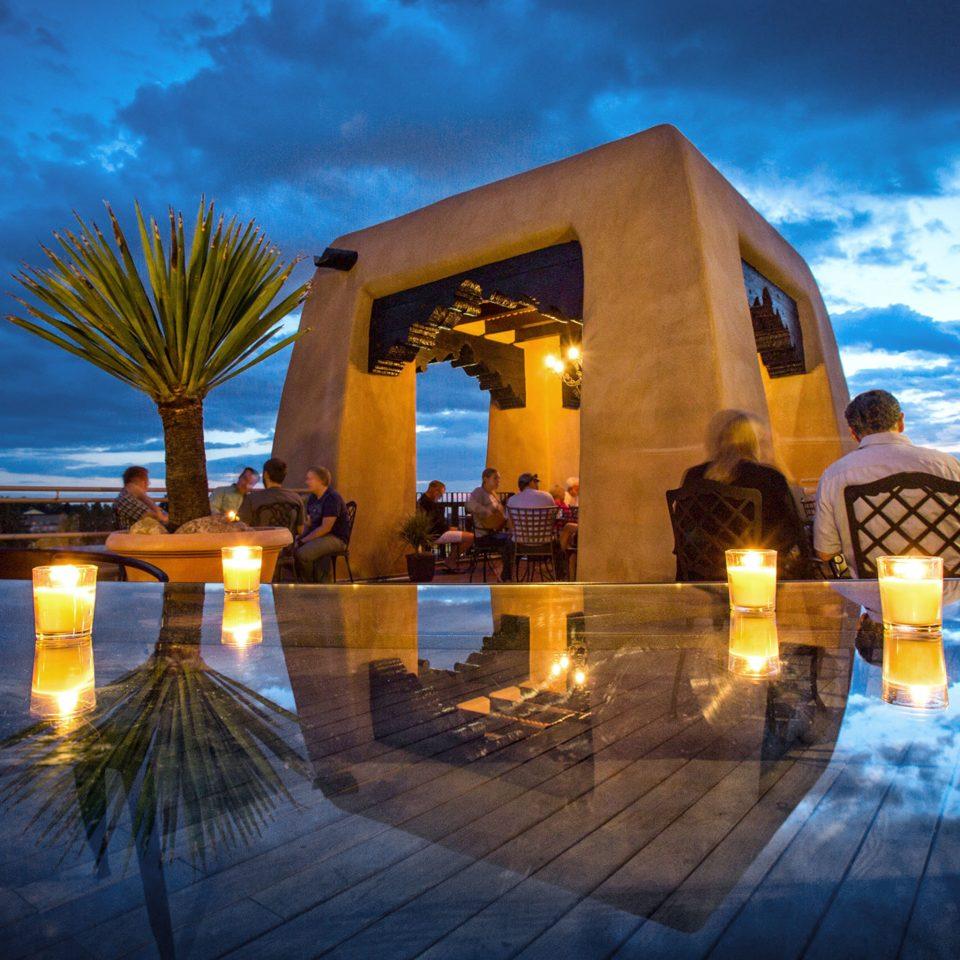 Bar Deck Dining Drink Eat Historic Lounge Luxury Patio Rooftop Terrace sky landmark night light evening swimming pool Resort lighting dusk sunlight