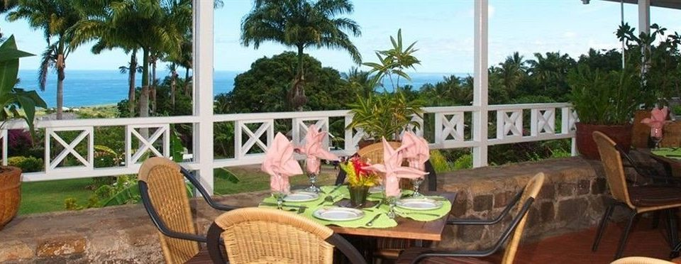 Bar Dining Drink Eat Lounge Tropical tree sky chair property Resort building hacienda porch home restaurant Villa cottage backyard Deck