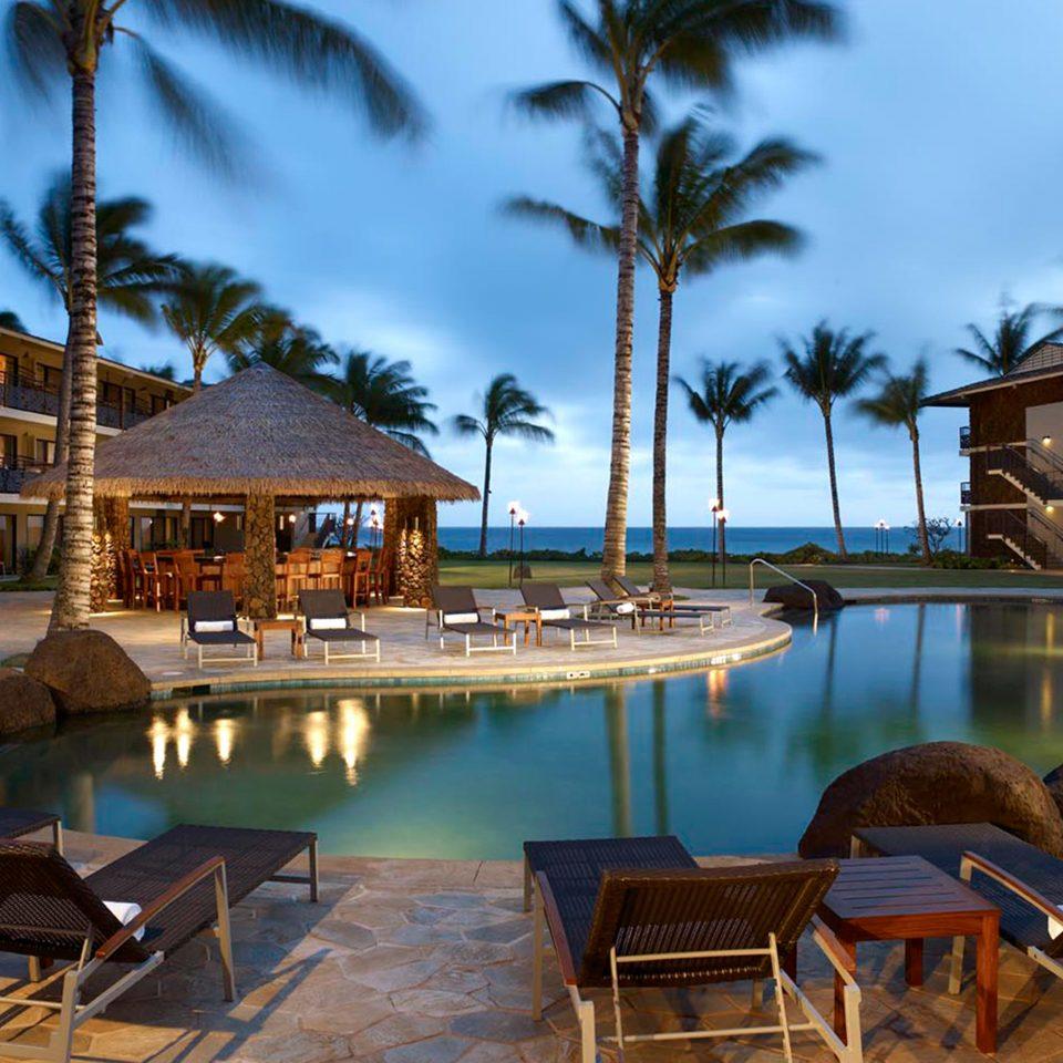 Bar Deck Exterior Honeymoon Hotels Island Luxury Outdoors Pool Resort Romance Romantic sky chair tree property lawn swimming pool home condominium Villa lined set swimming