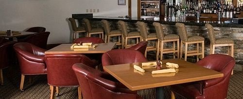 chair Dining property restaurant Bar wooden leather set dining table