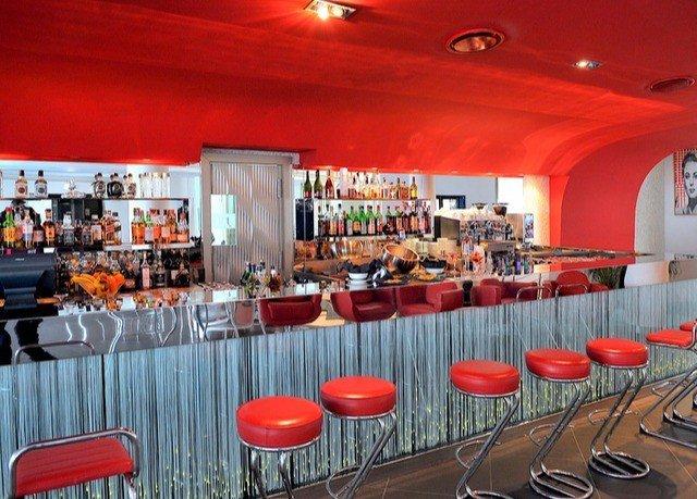 red chair orange restaurant function hall Bar Dining